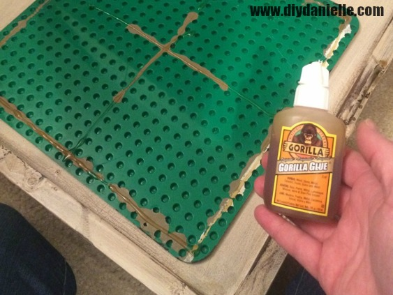 Use gorilla glue to attach your lego plate to the top of the table.