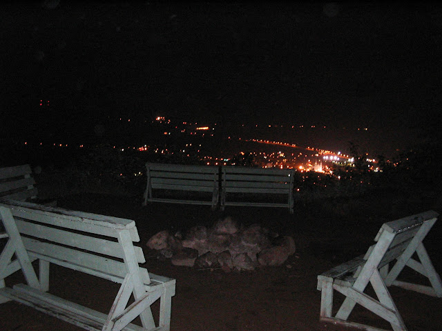 Picture of Baie Saint Paul at night with benches and fire pit in the foreground