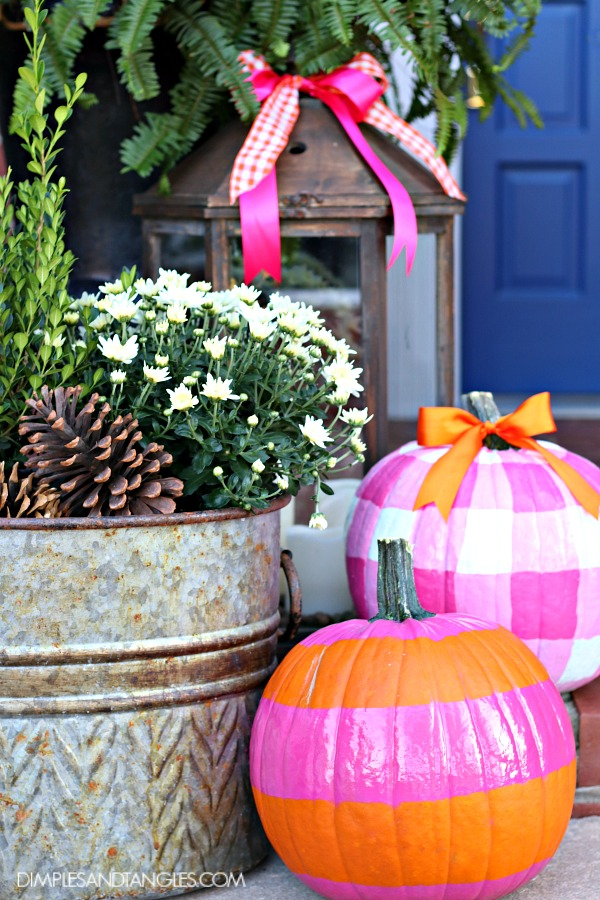 galvanized bucket, fall porch, fall decorations, painted pumpkins, hot pink and orange pumpkins, gingham pumpkin, lantern