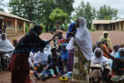 Women performing a skit in the village of Hindè.