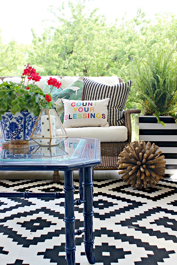 outdoor living space, outdoor decor, patio, Ikea lappljung ruta rug, bamboo table, ikea stockholm pillow, black and white stripes
