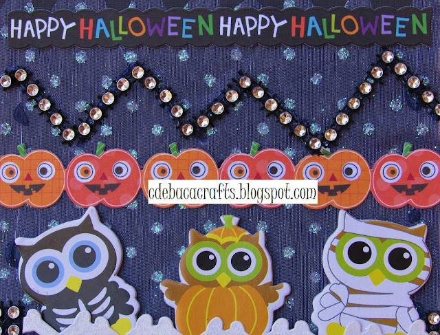 Handmade Halloween card with stickers and rhinestone by CdeBaca Crafts.