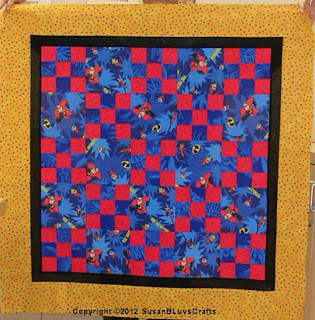 red and blue 9-patch quilt top