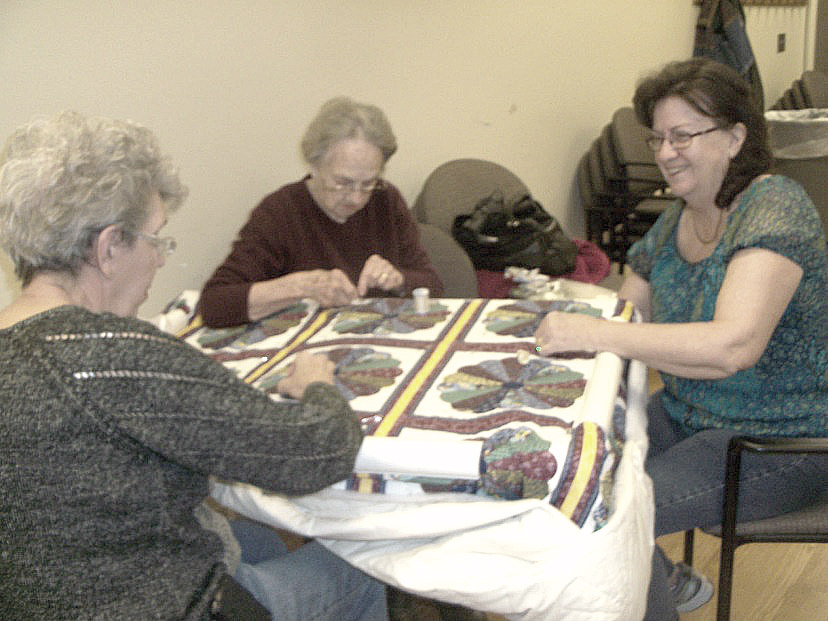photo of members quilting