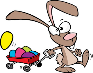 Clipart image of a cartoon Easter bunny pulling a red wagon full of coloured eggs