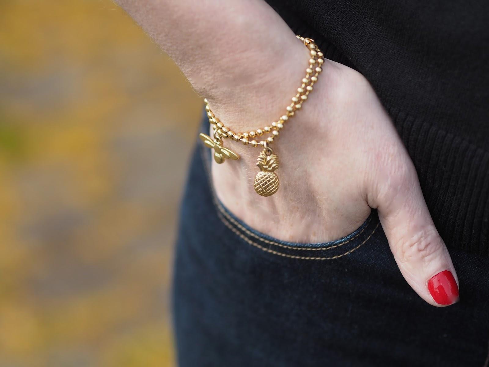 Danon gold honey bee bracelet and gold pineapple bracelet