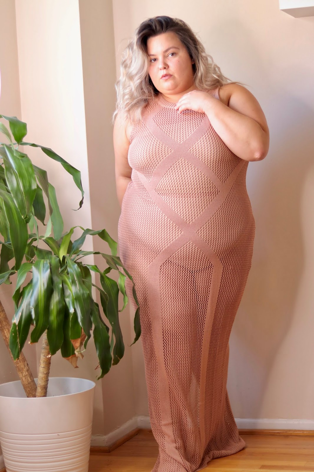 Chicago Plus Size Petite Fashion Blogger, influencer, YouTuber, and model Natalie Craig, of Natalie in the City, reviews Fashion Nova Curve's plus size crochet dresses for the beach, pool, and summer. beach cover ups
