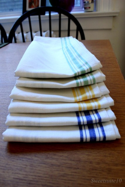 Tea towels with green, blue, and yellow stripes