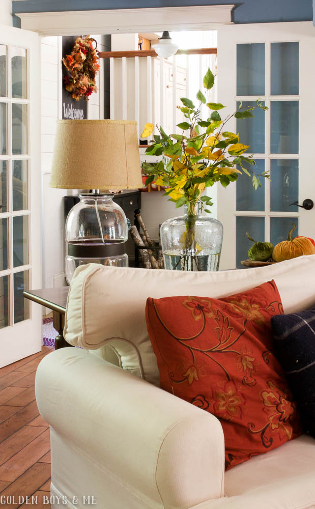 Fall family room with branches of changing leaves as decor - www.goldenboysandme.com