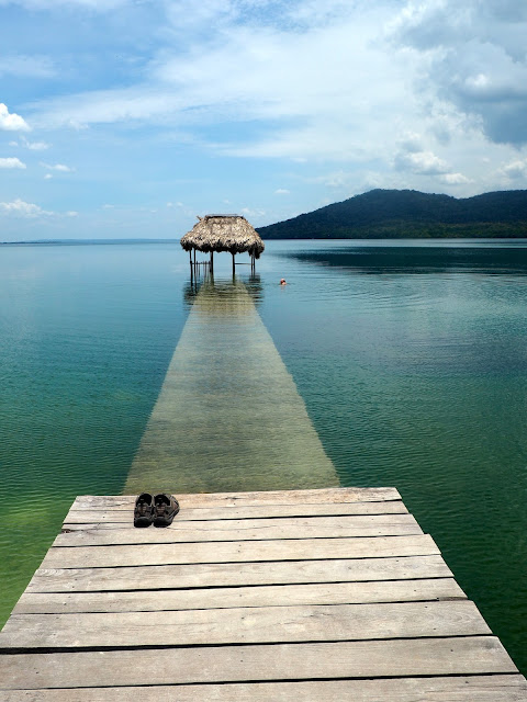 Pier by a lake on the road to Tikal, Guatemala