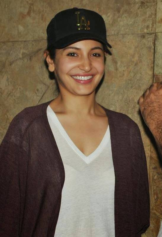 Bollywood Actress Anushka Sharma In White Top At Movie Screening