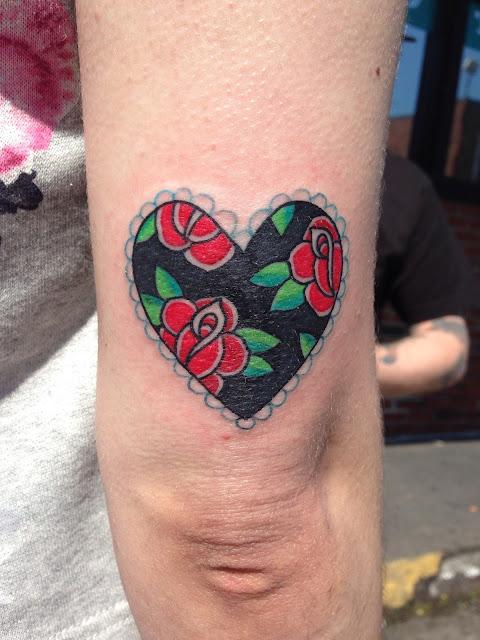 beautiful heart tattoo by Andrew Woodbury