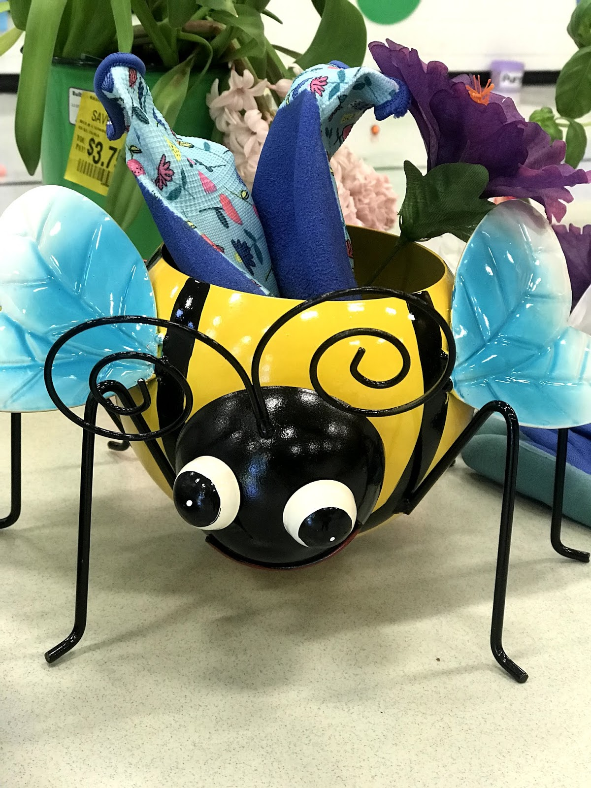 a close up of a bee decoration on the garden table.