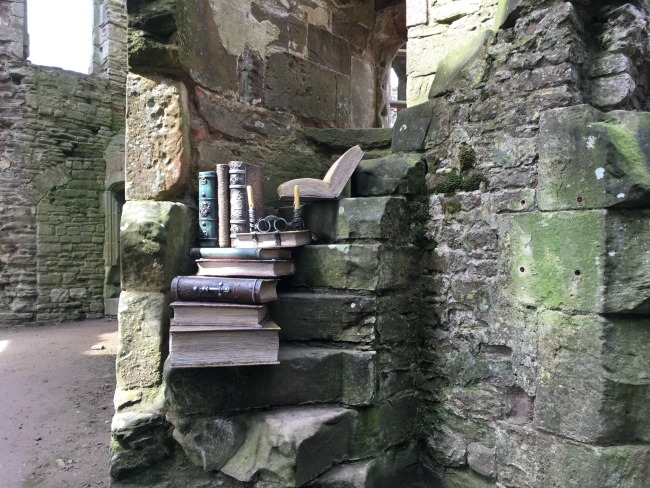 Raglan Castle - spiral staircase with model books on each step