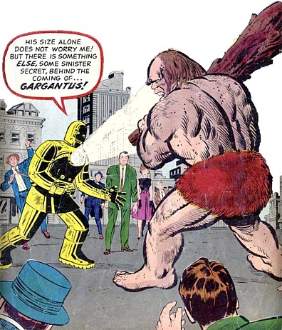 Iron Man confronts Gargantus, the hynotic robot neanderthal who has his club ready to bash him with