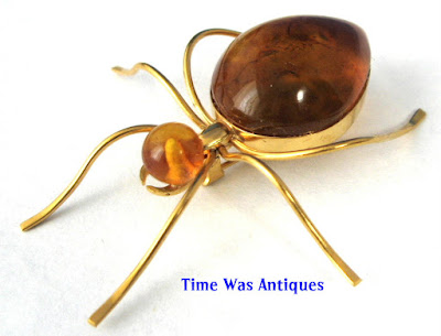 https://timewasantiques.net/products/spider-genuine-amber-1930s-signed-russian-8kt-gold-brooch-pin-hand-made-ussr