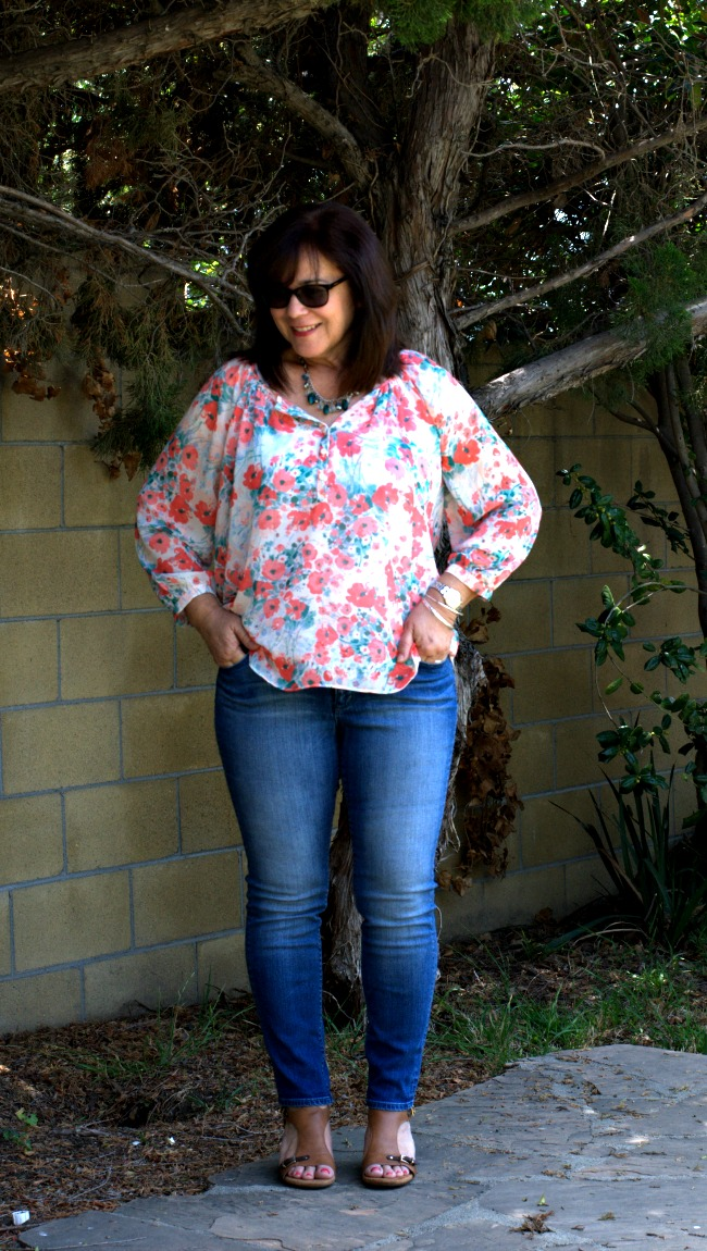 skinny jeans and loose fitting blouse