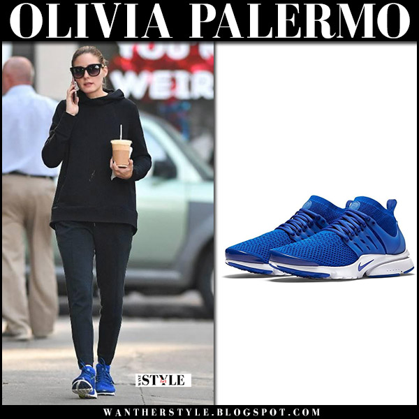 Olivia Palermo in black hoodie, black sweatpants and blue sneakers nike air presto street style november 3 2017