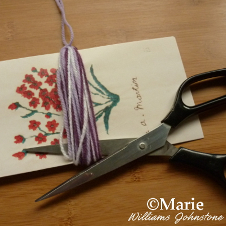 Cutting the yarn wool embellishment from the card