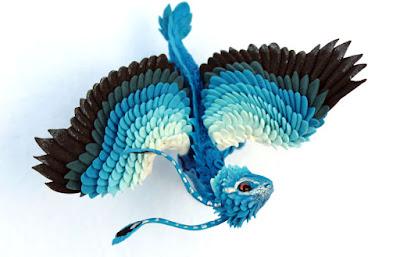 figura  de pez con alas de arcilla