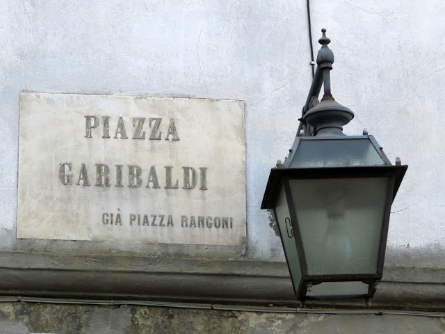 Street name sign in Piazza Garibaldi, formerly Piazza Rangoni, Livorno