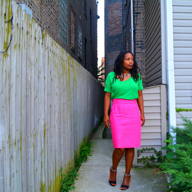 pink pencil skirt worn with a green tee