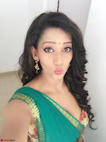 Sanjana Singh Looks Super cute in Green Saree Sleeveless Choli 1.JPG