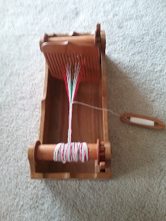 Medieval-style band or tape loom with rigid heddle, made by JK Seidel.