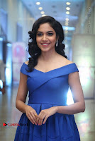 Actress Ritu Varma Pos in Blue Short Dress at Keshava Telugu Movie Audio Launch .COM 0047.jpg