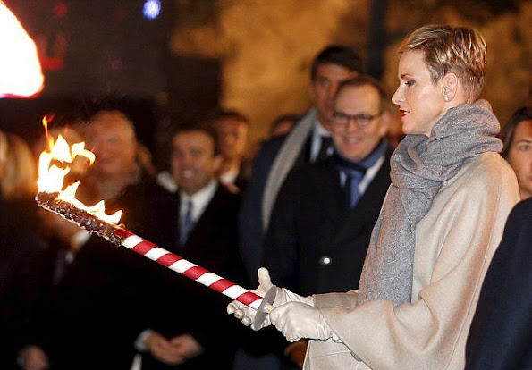 Princess Charlene of Monaco and Prince Albert II of Monaco attend the Sainte-Devote ceremony