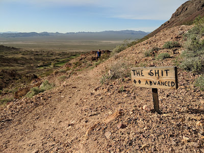 "A sign for the mountain bike trail called ""The Shit""."