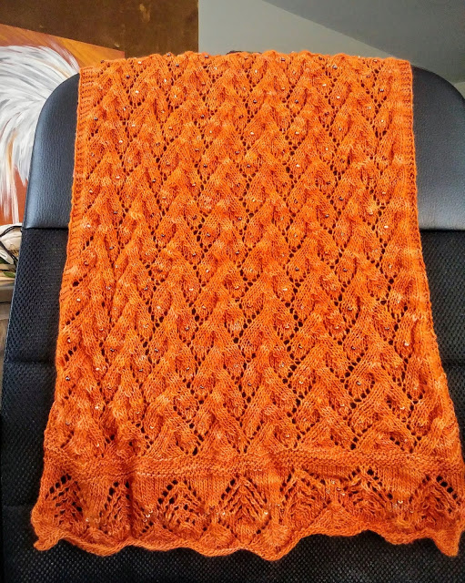 Knitting a beaded Estonian lace shawl with malabrigo lace weight yarn.