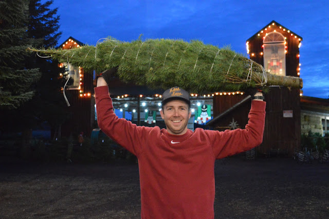 Blake holding our Christmas tree.