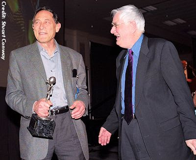 Mack, a year before his death, with Budd Hopkins, the American artist and abduction researcher, at the International U.F.O. Congress Awards in 2003