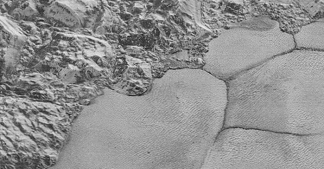This image taken during the New Horizons mission shows the mountain range on the edge of the Sputnik Planitia ice plain, with dune formations clearly visible in the bottom half of the picture. Credit: NASA/Johns Hopkins University Applied Physics Laboratory/Southwest Research Institute