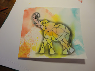 Elephant image with red, yellow, blue clouds behind