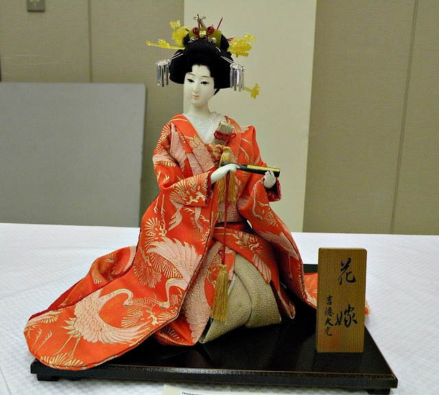 Traditional Japanese doll Hanayome dressed in traditional wedding costume