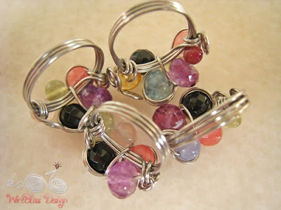 Wire wrapped fruity rings with garnet, amethyst, aquamarine, agate, prehnite