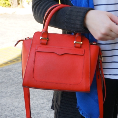 Rebecca Minkoff red micro Avery cross body bag on arm with black | awayfromtheblue