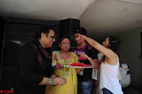 Govinda celeting Holi with His family wife daughter 014.JPG