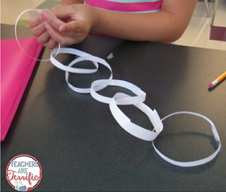 STEM Challenge: Make a paper chain using one piece of paper! What a great community building activity this is!