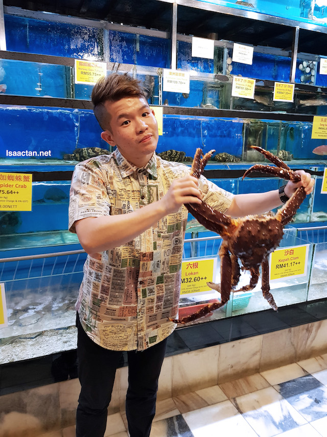 Our makan kaki that evening, Kevin posing with a rather large crab