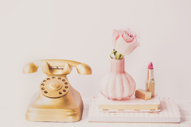 A phone and flowers in a home with a cleaning schedule for working mums