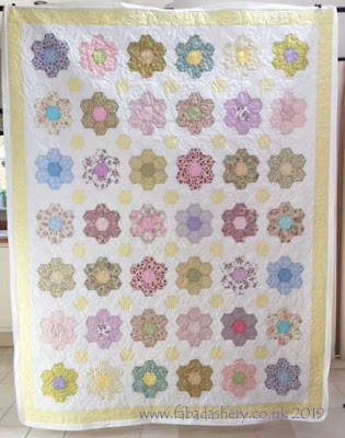 Grandmother's Flower Garden quilt, made by Christine