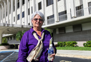 Rose Marks, a Fort Lauderdale psychic, leaves the federal courthouse in West Palm Beach in 2013. (Lannis Waters/The Palm Beach Post)
