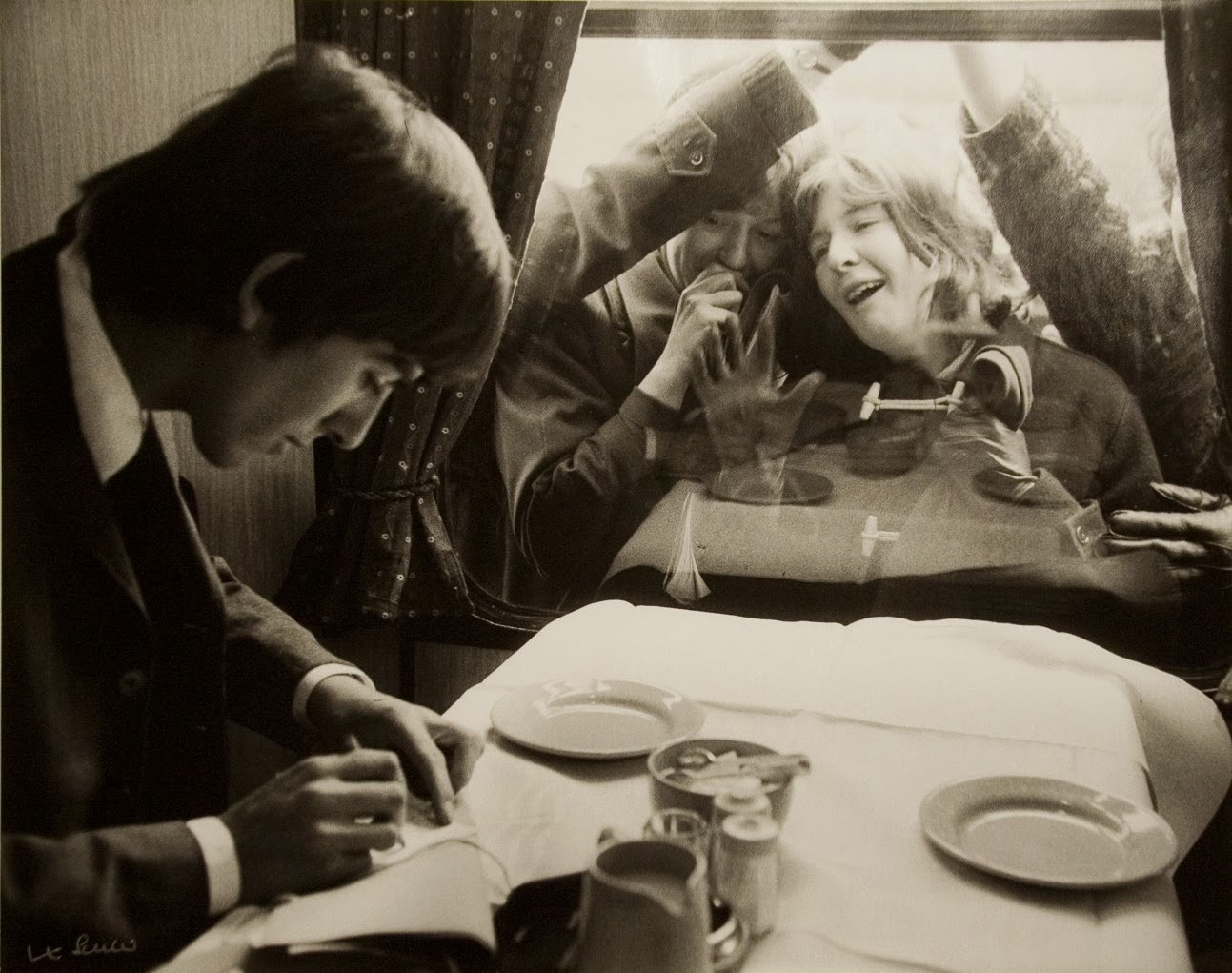 George Harrison Writing Autographs For Fans London 1964