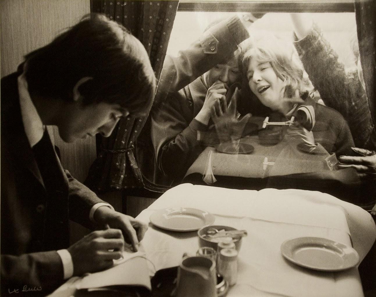 George Harrison Writing Autographs For Fans London 1964