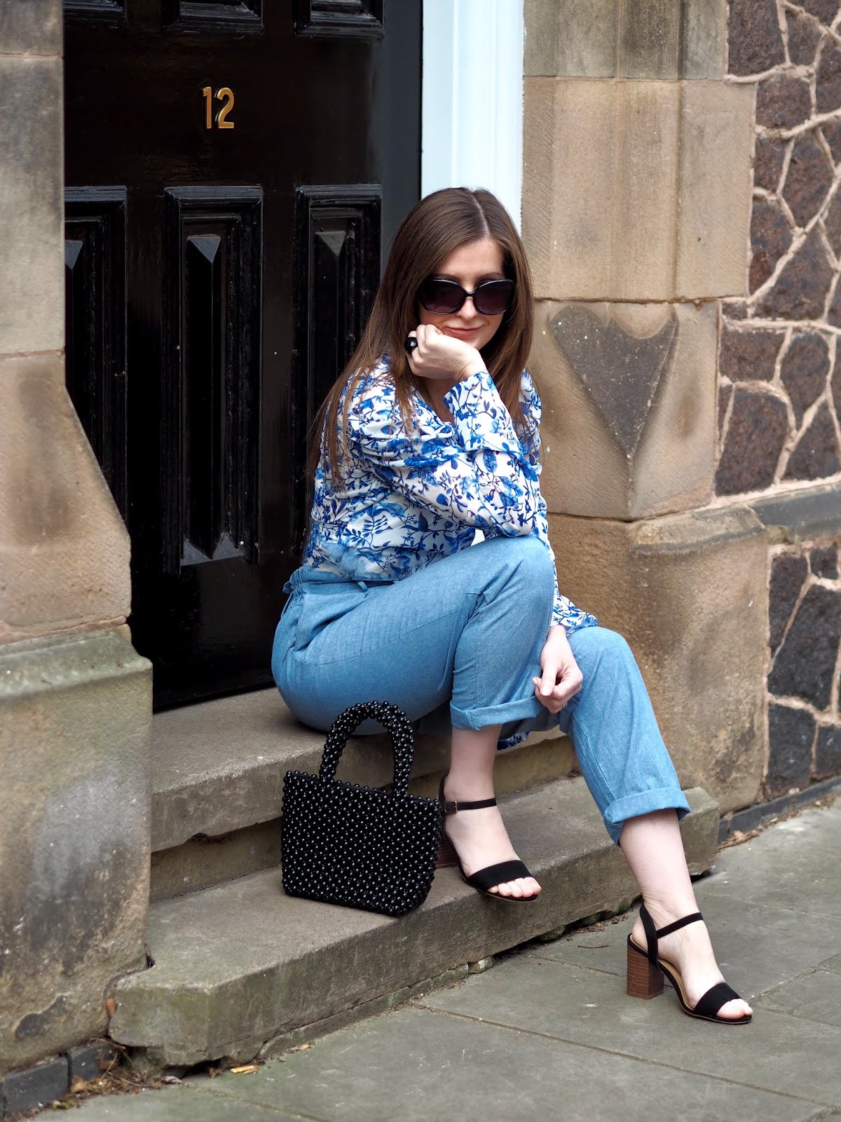 Practically perfect wrap top by Lorna Luxe styled with high waisted trousers and sandals