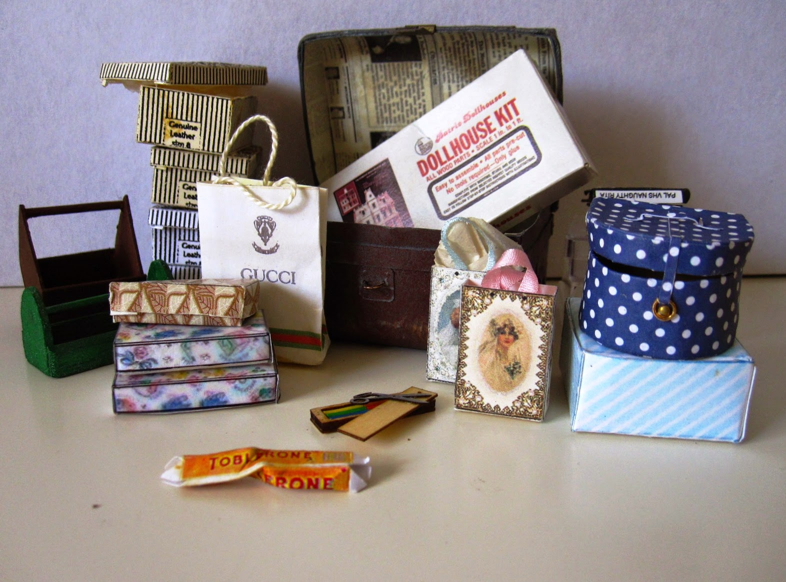 Selection of miniature vintage bags, boxes and a trunk.