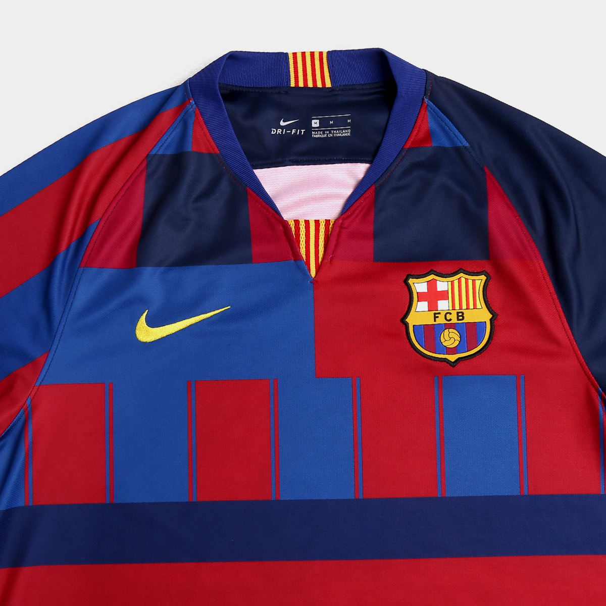 a05c228ae6d The Nike FC Barcelona Mashup soccer jersey features elements of all Barcelona  kits worn by the club over the last two decades.